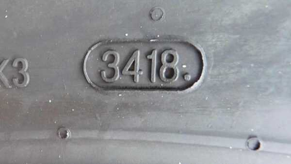 The tire date of manufacture is stamped on the side of the tire with a four letter code