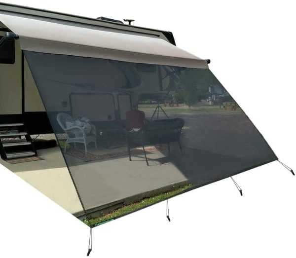RV awning sun shade tied to stakes using bungee cords